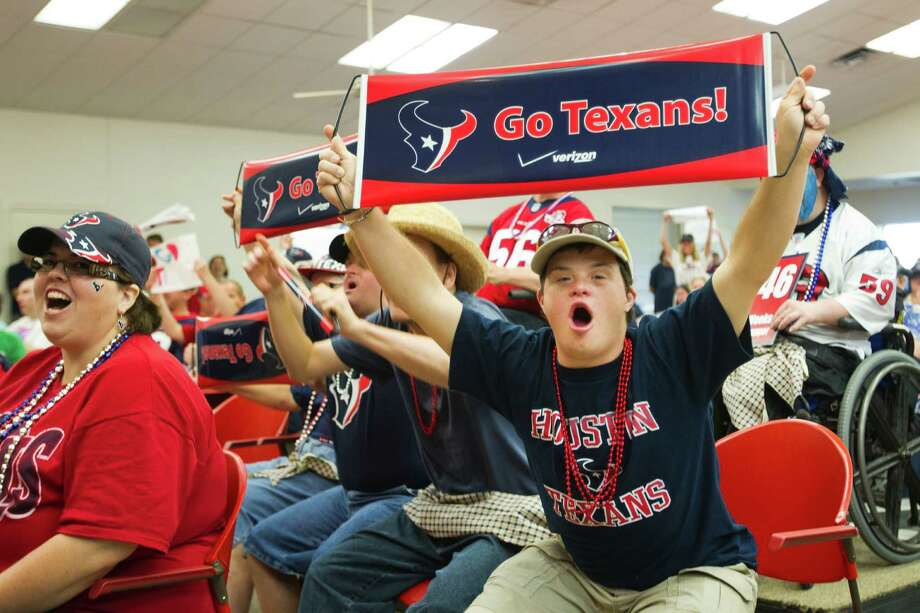 Patrick, a Brookwood Community citizen, cheers as Houston punter Shane Lechler, kicker Randy Bullock and long snapper Jon Weeks make an appearance for a pep rally at the Brookwood Community Tuesday, Sept. 24, 2013, in Brookshire. The Texans special teams players attended a pep rally with the citizens of the Brookwood Community in conjunction with the Special Teams for Special Needs program presented by Mustang CAT. Mustang CAT will make a donation to Brookwood Community, a non-profit residential facility and vocational program for functionally disabled adults. Photo: Brett Coomer, Houston Chronicle / © 2013 Houston Chronicle