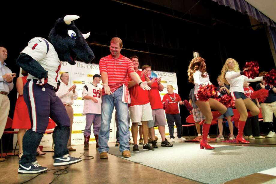 Houston Texans mascot Toro does a dance on the stage with Texans punter Shane Lechler and cheerleaders at Brookwood Community Tuesday, Sept. 24, 2013, in Brookshire. Photo: Brett Coomer, Houston Chronicle / © 2013 Houston Chronicle
