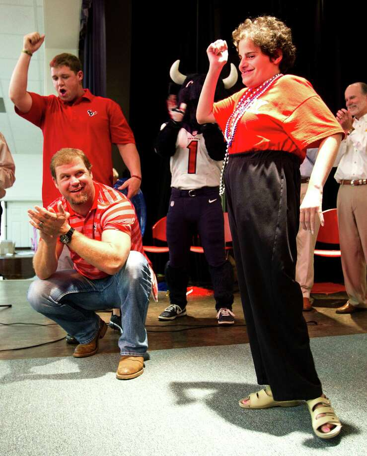 Houston Texans punter Shane Lechler, kneeling, and long snapper Jon Weeks cheer after Linley, a Brookwood Community citizen, kicked a field goal Tuesday, Sept. 24, 2013, in Brookshire. Photo: Brett Coomer, Houston Chronicle / © 2013 Houston Chronicle