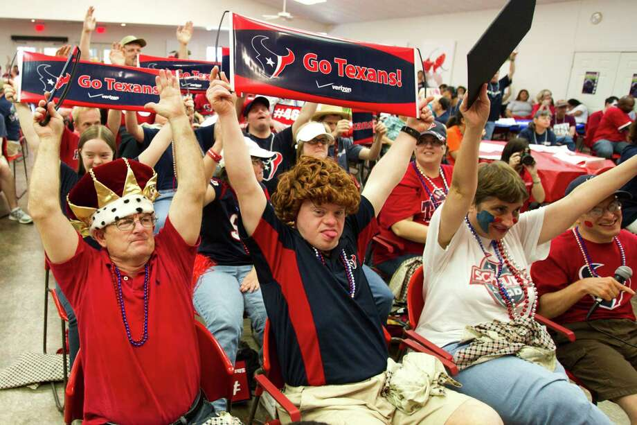 Brookwood Community citizens cheer as Houston Texans punter Shane Lechler, kicker Randy Bullock and long snapper Jon Weeks (46) make an appearance Tuesday, Sept. 24, 2013, in Brookshire. Photo: Brett Coomer, Houston Chronicle / © 2013 Houston Chronicle