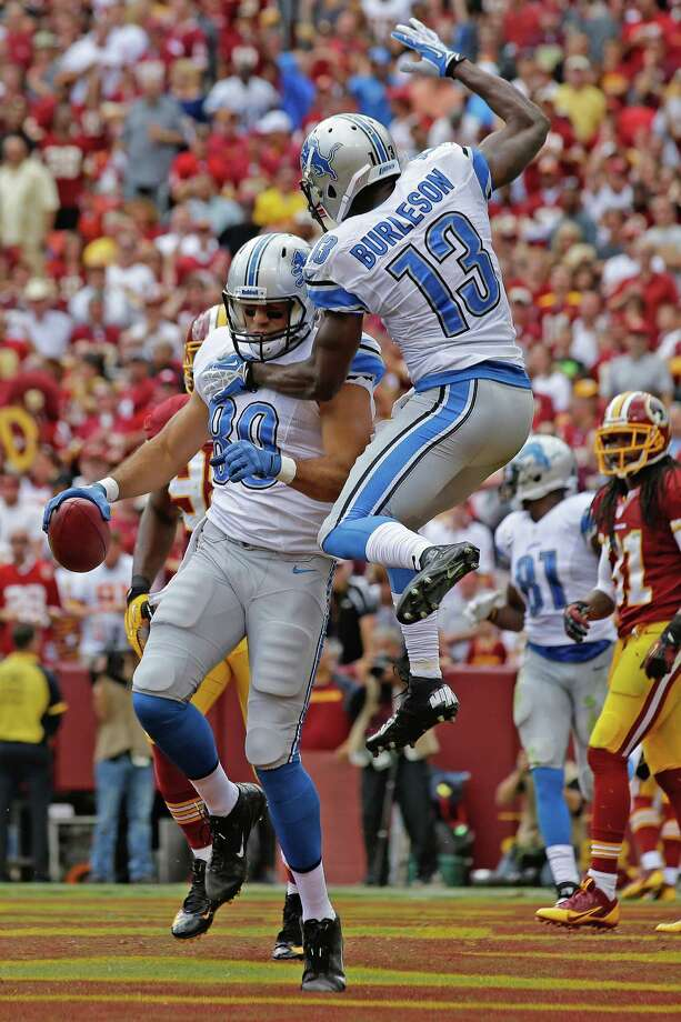 Detroit Lions tight end Joseph Fauria celebrates his touchdown reception with wide receiver Nate Burleson (13) during the first half of a NFL football game against the Washington Redskins in Landover, Md., Sunday, Sept. 22, 2013. Photo: Alex Brandon
