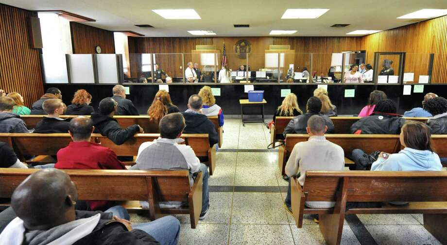 With every seat filled, Albany City Court Judge Thomas Keefe, center, prepares for court Wednesday Oct. 31, 2012.  (John Carl D'Annibale / Times Union) Photo: John Carl D'Annibale / 10019886A