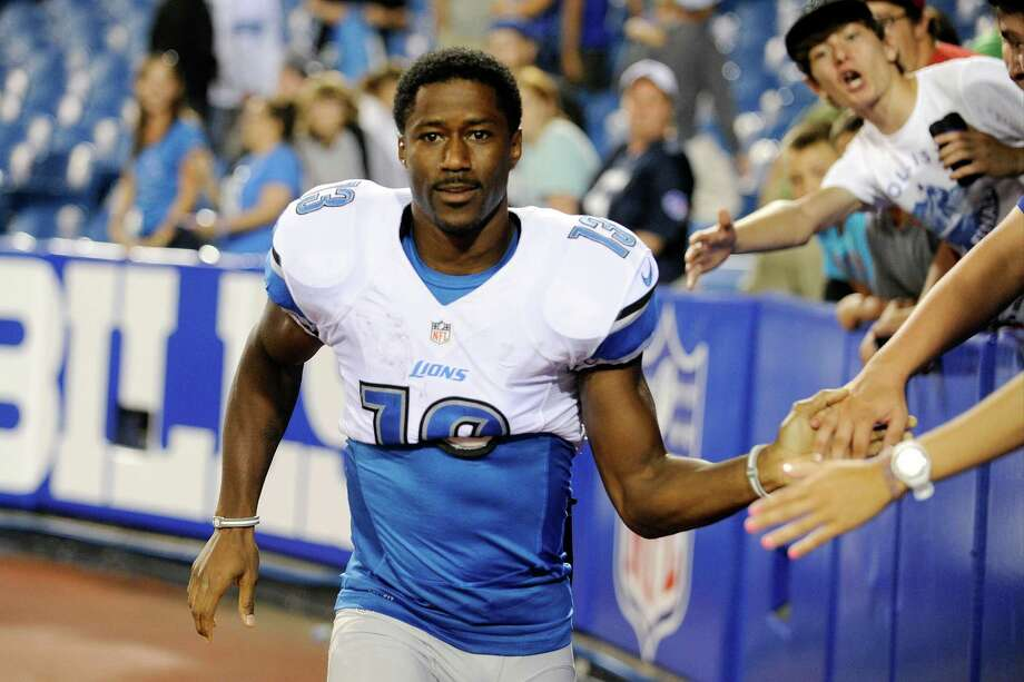 FILE - In this Aug. 29, 2013 file photo, Detroit Lions wide receiver  Nate Burleson (13) walks away from fans after signing autographs after an NFL football game against the Buffalo Bills in Orchard Park, N.Y. The Detroit Lions say Burleson was in a one-car accident and needs surgery on a broken arm. The team said in a statement Tuesday morning, Sept. 24, 2013, that the police have confirmed alcohol was not involved. (AP Photo/Gary Wiepert, File) ORG XMIT: NY155 Photo: Gary Wiepert / FR170498 AP