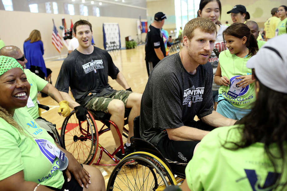 Spurs players including Matt Bonner, right, and Aron Baynes, left, talk with Valor Games athletes and fans after they played the 3v3 wheelchair basketball competition winning team during the 3v3 wheelchair basketball exhibition during the Valor Games Southwest at Mission Concepcion Sports Park in San Antonio on Tuesday, September 24, 2013. Photo: Lisa Krantz, San Antonio Express-News / San Antonio Express-News