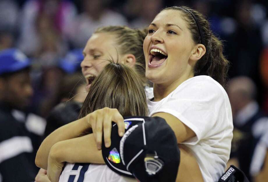 Connecticut forward Breanna Stewart smiles as she embraces teammate Stefanie Dolson after beating Kentucky in the women's NCAA regional final basketball game in Bridgeport, Conn., Monday, April 1, 2013. Connecticut won 83-53 and advances to the Final Four. (AP Photo/Charles Krupa) Photo: Charles Krupa, Associated Press / Associated Press