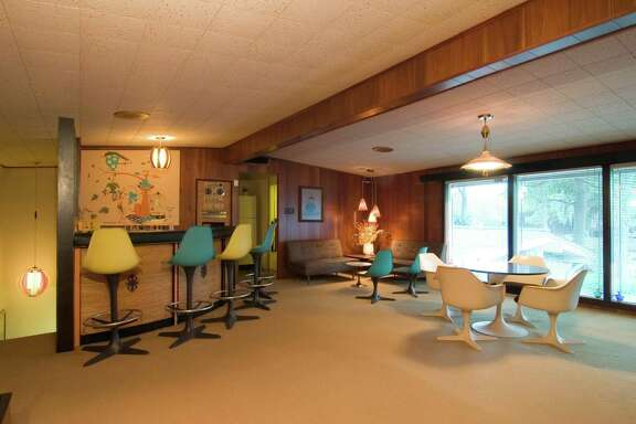 """The Kit Kat Lounge"" is in a house in Glenbrook Valley. Its furniture is original to the house. A resident says neighborhood homes are designed for entertaining, with party rooms and built-in martini bars."