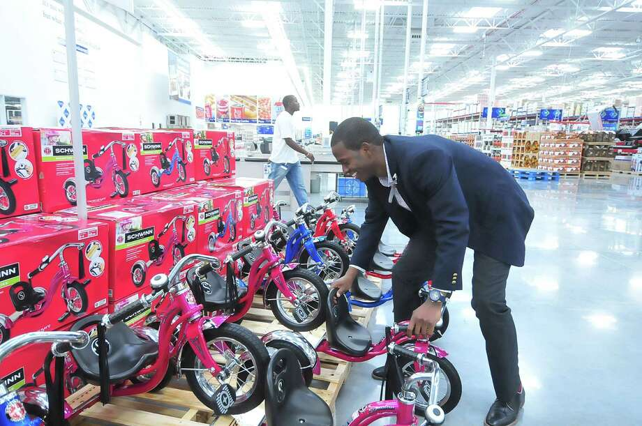 Store manager Robert Williams helps stack tricycles in preparation for the opening of the Sam's Club at 13331 Westheimer. Photo: Â Tony Bullard 2013, Freelance Photographer / © 2013 Tony Bullard