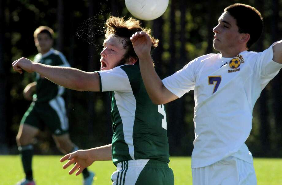 Schalmont's Greg Musk, center, and Voorheesville's Dylan Hensel battle for the ball during their boy's high school soccer matchup on Tuesday Sept. 24, 2013 in Voorheesville, N.Y. (Michael P. Farrell/Times Union) Photo: Michael P. Farrell / 00023960A