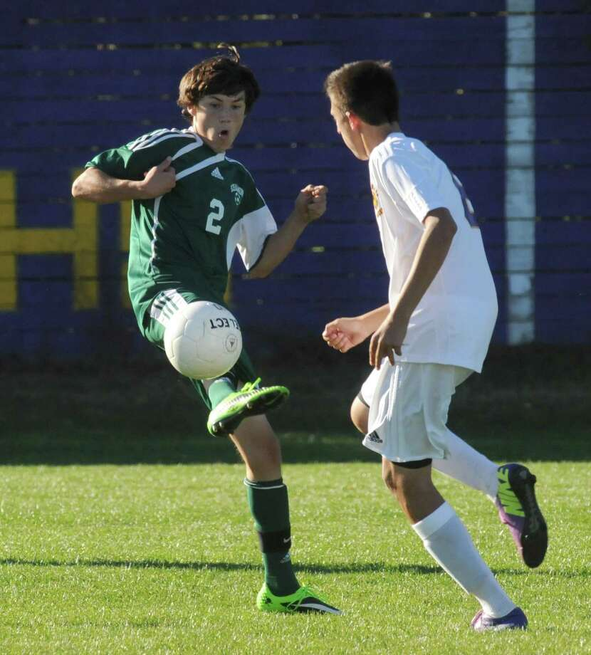 Schalmont's Cameron LaVallee, left, and Voorheesville's Nick Windsor battle for the ball during their boy's high school soccer matchup on Tuesday Sept. 24, 2013 in Voorheesville, N.Y. (Michael P. Farrell/Times Union) Photo: Michael P. Farrell / 00023960A