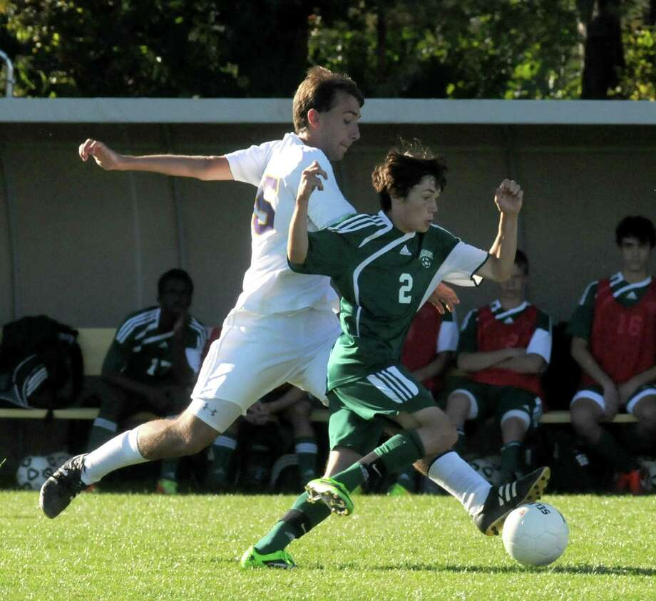 Schalmont's Cameron LaVallee, right, and Voorheesville's Christian Keenan battle for the ball during their boy's high school soccer matchup on Tuesday Sept. 24, 2013 in Voorheesville, N.Y. (Michael P. Farrell/Times Union) Photo: Michael P. Farrell / 00023960A