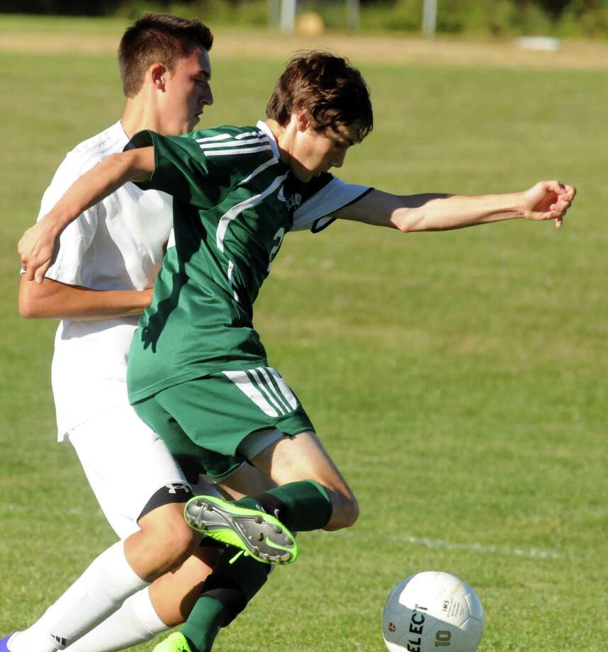 Schalmont's Cameron LaVallee, right, and Voorheesville's Nick Windsor battle for the ball during their boy's high school soccer matchup on Tuesday Sept. 24, 2013 in Voorheesville, N.Y. (Michael P. Farrell/Times Union) Photo: Michael P. Farrell / 00023960A
