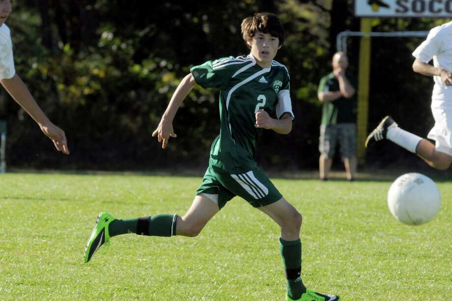 Schalmont's Cameron LaVallee,center, during their boy's high school soccer matchup against Voorheesville on Tuesday Sept. 24, 2013 in Voorheesville, N.Y. (Michael P. Farrell/Times Union) Photo: Michael P. Farrell / 00023960A