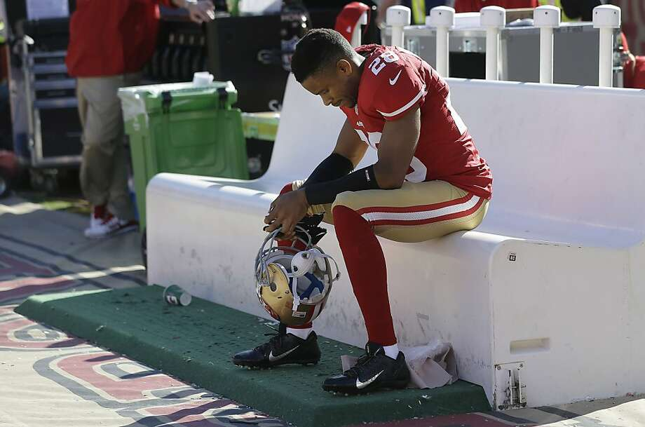 San Francisco 49ers cornerback Nnamdi Asomugha (28) sits on the bench during the fourth quarter of an NFL football game against the Indianapolis Colts in San Francisco, Sunday, Sept. 22, 2013. The Colts won 27-7. (AP Photo/Marcio Jose Sanchez) Photo: Marcio Jose Sanchez, Associated Press