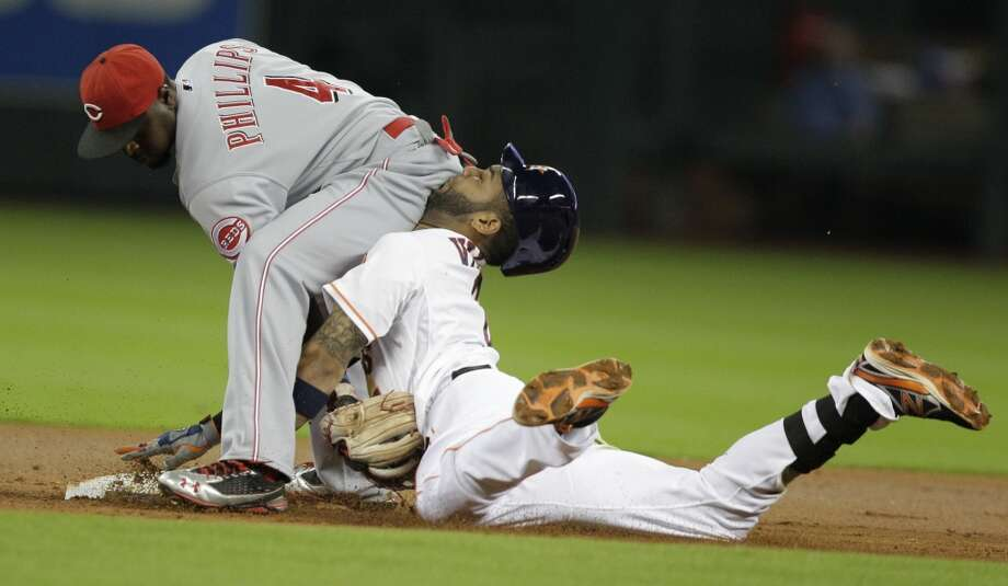 "On the night the Astros lost their 100th game, Jonathan Villar tried to stretch a single into a double against the Reds. He wound up sliding right into the butt of second baseman Brandon Phillips, who was awaiting the throw. As Villar went face first into Phillips, he was tagged out and destined for the tabloids and SportsCenter. The ""butt slide"" had its few minutes of fame. Photo: Melissa Phillip, Houston Chronicle"