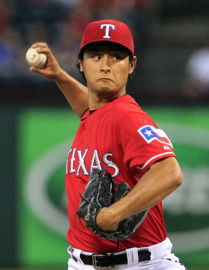 Rangers pitcher Yu Darvish delivers a throw to the Astros. Photo: John F. Rhodes, Associated Press