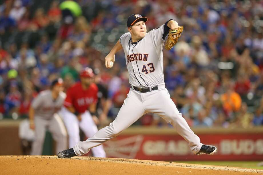 Astros pticher Brad Peacock delivers a throw to the Rangers. Photo: Ronald Martinez, Getty Images