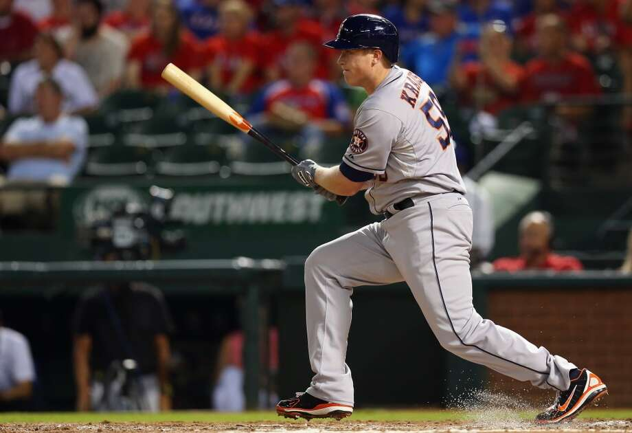 Marc Krauss of the Astros swings against the Rangers. Photo: Ronald Martinez, Getty Images