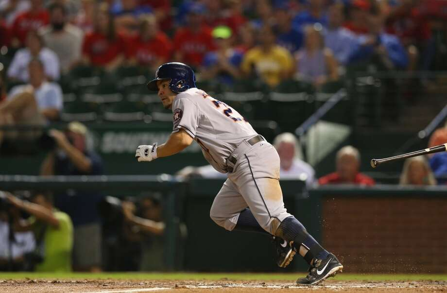 Astros second baseman Jose Altuve records a single against the Rangers in the fifth inning. Photo: Ronald Martinez, Getty Images