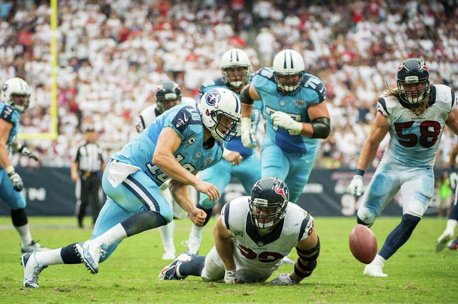 The Texans' defense has played well since a rough start in San Diego but has not been that disruptive, forcing only one turnover and missing out on chances like this fumble by Titans quarterback Jake Locker. Photo: Smiley N. Pool, Staff / © 2013  Houston Chronicle
