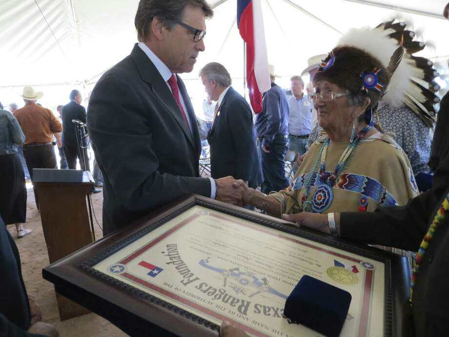 Gov. Rick Perry speaks with Anna Tahmahkera, a Comanche who was made an honorary member of the Former Texas Rangers Foundation during the ground- breaking ceremony for the Texas Rangers Heritage Center in Fredericks-burg. Photo: Zeke MacCormack / San Antonio Express-News