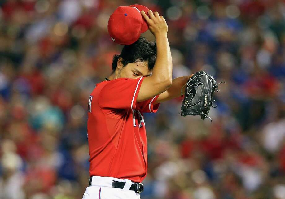 The Astros made Yu Darvish work harder Tuesday night than in previous outings against them this season, but he still emerged with a win. Photo: Ronald Martinez, Staff / 2013 Getty Images