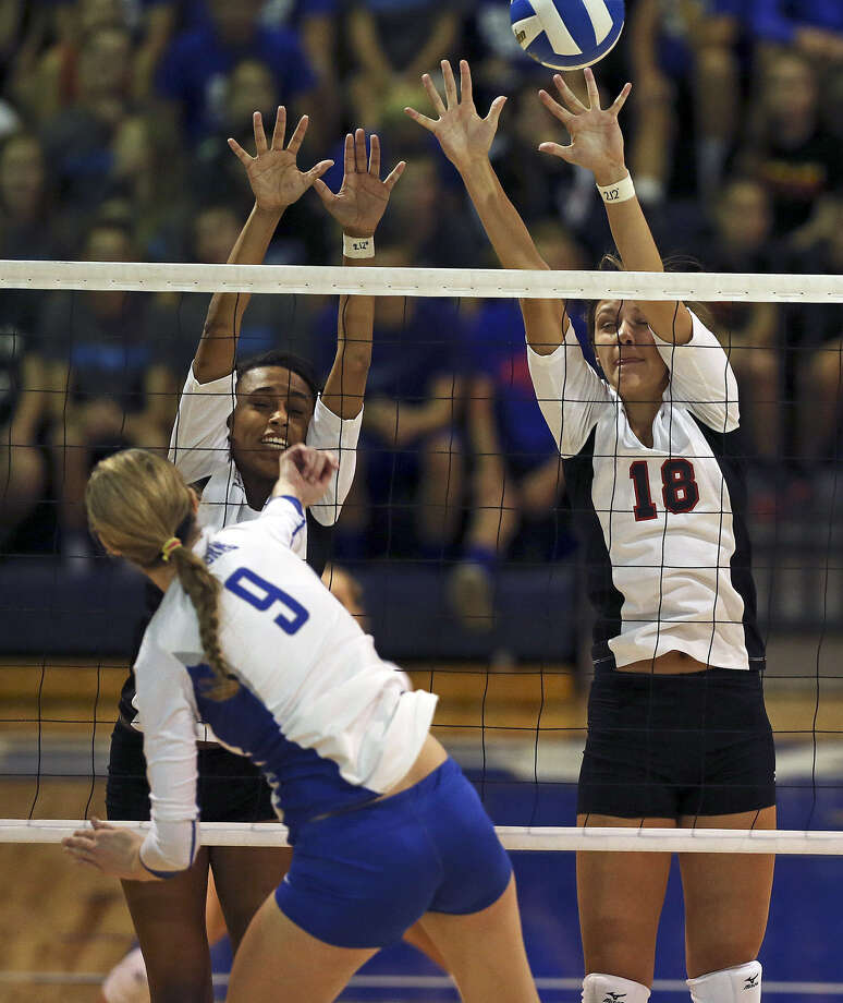 Churchill's Dariaan Gilford (back left) and Taylor Martinez defend a spike by New Braunfels' Neka Cuppetilli. The top-ranked Chargers defeated the Unicorns 25-18, 25-15, 23-25, 26-24. Photo: Tom Reel / San Antonio Express-News