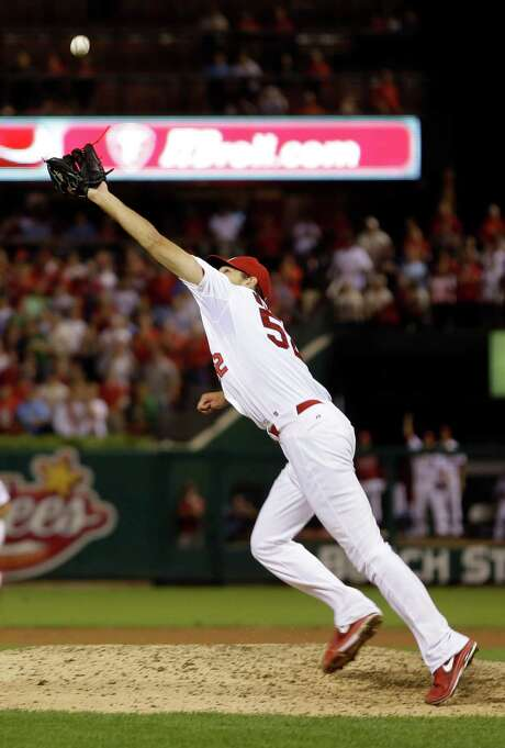 Even at 6-6, Michael Wacha can't come up with the chopper by the Nationals' Ryan Zimmerman that ended up as the only hit allowed by the Cardinals rookie. Photo: Jeff Roberson, STF / AP