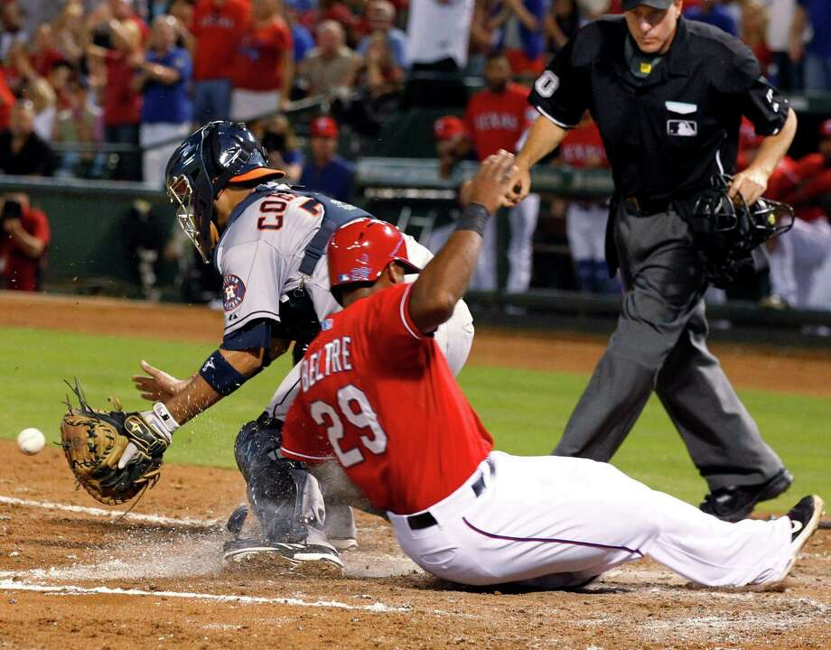 The Rangers' Adrian Beltre erases the Astros' 1-0 lead by beating Carlos Corporan's tag to score on Geovany Soto's single in the fourth inning Wednesday night. Photo: John F. Rhodes, FRE / FR170608 AP