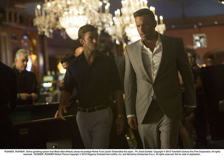 "Justin Timberlake (left) plays the protege of an online gambling tycoon (Ben Affleck) in ""Runner Runer,"" opening Friday. Photo: 20th Century Fox"