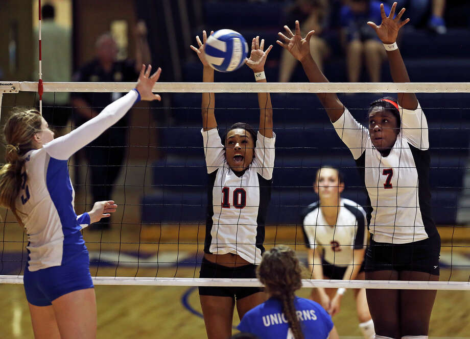 Chargers Dariann Gilford  (10) and Charline Coupet stop as shot as New Braunfels hosts Churchill in high school volleyball at New Braunfels High School on  on September 24, 2013. Photo: Tom Reel, San Antonio Express-News