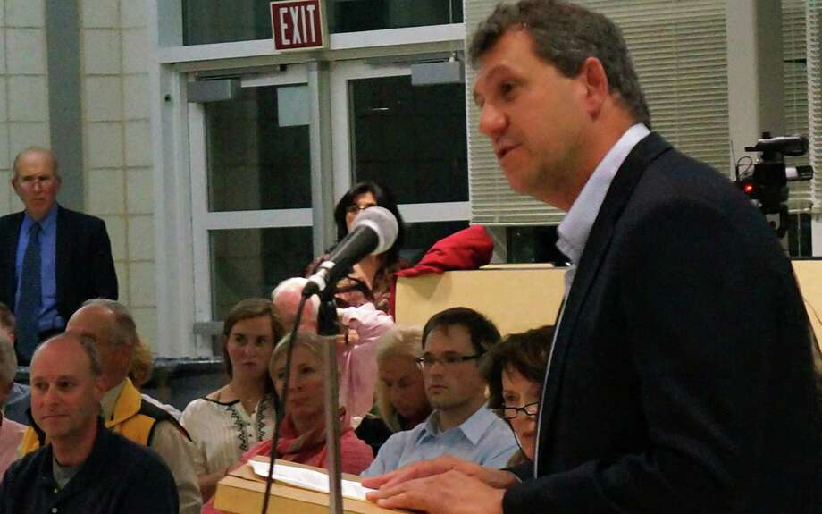 David Lipton, of CT Wellness Center which has applied to open a medical marijuana dispensary at 222 Post Road, speaks about the proposal Tuesday night at the Town Plan and Zoning Commission meeting.  FAIRFIELD CITIZEN, CT 9/24/13 Photo: Genevieve Reilly / Fairfield Citizen contributed