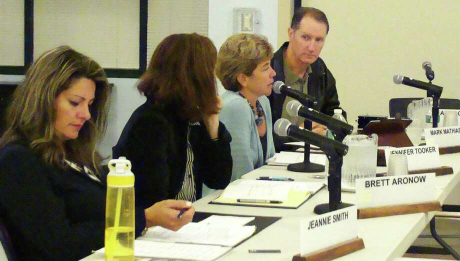Board of Education member Jennifer Tooker, third from left, discusses proposed changes in the school district's suicide-pevention policy at Monday's meeting.  WESTPORT NEWS, CT 9/23/13 Photo: Meg Barone / Westport News contributed