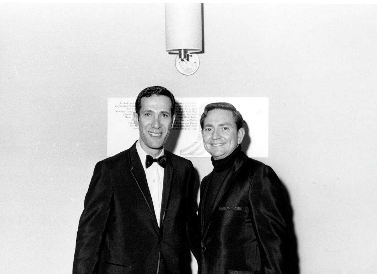 Everybody's brother Willie: Nelson poses for a portrait with a man at the Hotel Taft on October 27, 1967 in New York City, New York.