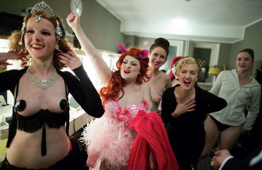 Burlesque artists from left, Minouche von Marabou of Switzerland, Lady Francescca of Sweden, Giddy Heights of Great Britain, Little Miss Piss of Germany and Valentina of New Zealand laugh at backstage before the Newcomer Night of the first international Berlin Burlesque Festival in Berlin, Germany, Thursday, Sept. 19, 2013. The artists from overseas take part in the four-day festival which includes three different evening shows. Photo: AP