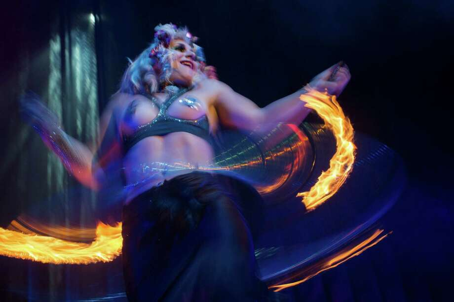Burlesque artist Anna the Hulagan of Great Britain performs with her fiery hula hoop during the Odd Night, the second show of the first international Berlin Burlesque Festival in Berlin, Germany, Friday, Sept. 20, 2013. The four-day festival including three different evening shows and different workshops hosts some 36 international burlesque artists. Photo: AP