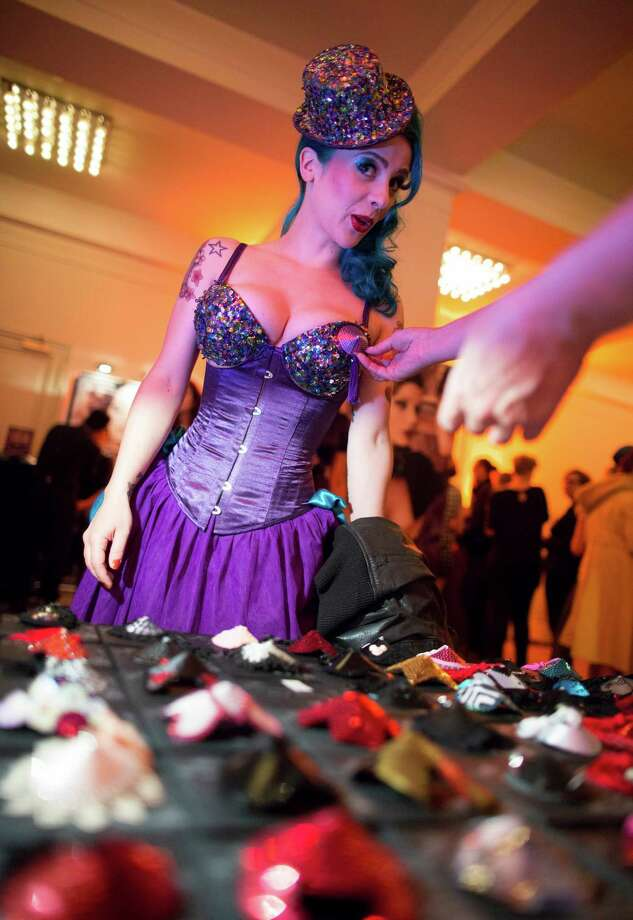 A spectator tries out nipples pasties at a sales booth during the Newcomer Night of the first international Berlin Burlesque Festival in Berlin, Germany, Thursday, Sept. 19, 2013. The four-day festival including three different evening shows and different workshops hosts some 36 international burlesque artists. Photo: AP