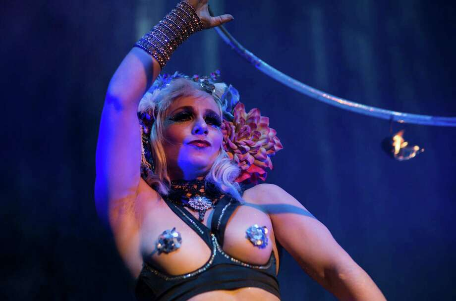 Burlesque artist Anna the Hulagan of Great Britain performs with her hula hoop during the Odd Night, the second show of the first international Berlin Burlesque Festival in Berlin, Germany, Friday, Sept. 20, 2013. The four-day festival including three different evening shows and different workshops hosts some 36 international burlesque artists. Photo: AP
