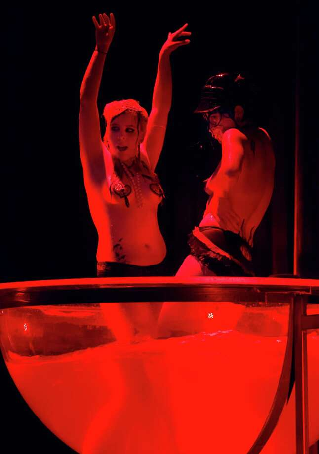 Burlesque artist Magenta Lust of Scotland, left, performs with another burlesque artist during the Odd Night, the second show of the first international Berlin Burlesque Festival in Berlin, Germany, Friday, Sept. 20, 2013. The four-day festival including three different evening shows and different workshops hosts some 36 international burlesque artists. Photo: AP