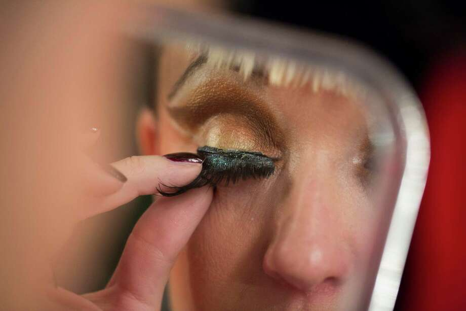 Burlesque artist Diva Hollywood of Britain fixes her false eyelashes backstage for their performance at the Odd Night, the second show of the first international Berlin Burlesque Festival in Berlin, Germany, Friday, Sept. 20, 2013. The four-day festival including three different evening shows and different workshops hosts some 36 international burlesque artists. Photo: AP
