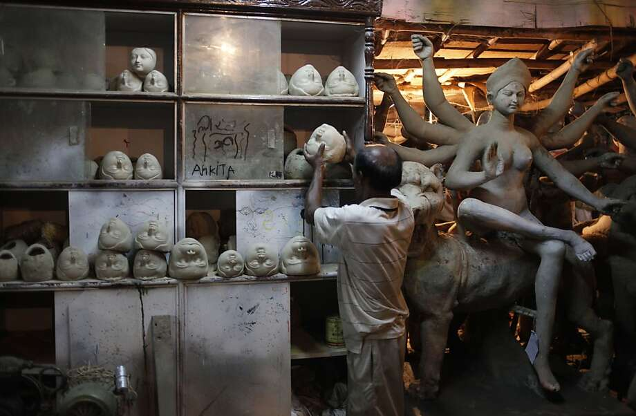 Now, where did I put that other head...An Indian artist prepares idols of Hindu goddess Durga ahead of the Durga Puja festival in Allahabad. The five-day festival that begins Oct. 9 commemorates the slaying of a demon king by goddess Durga marking the triumph of good over evil. Photo: Rajesh Kumar Singh, Associated Press