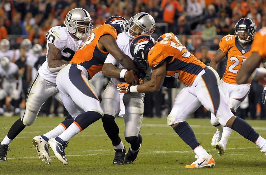 Oakland Raiders quarterback Terrelle Pryor (2) is hit by Denver Broncos outside linebacker Wesley Woodyard (52) and linebacker Danny Trevathan (59)during an NFL football game, Monday, Sept. 23, 2013, in Denver. (AP Photo/Jack Dempsey) Photo: Jack Dempsey, Associated Press
