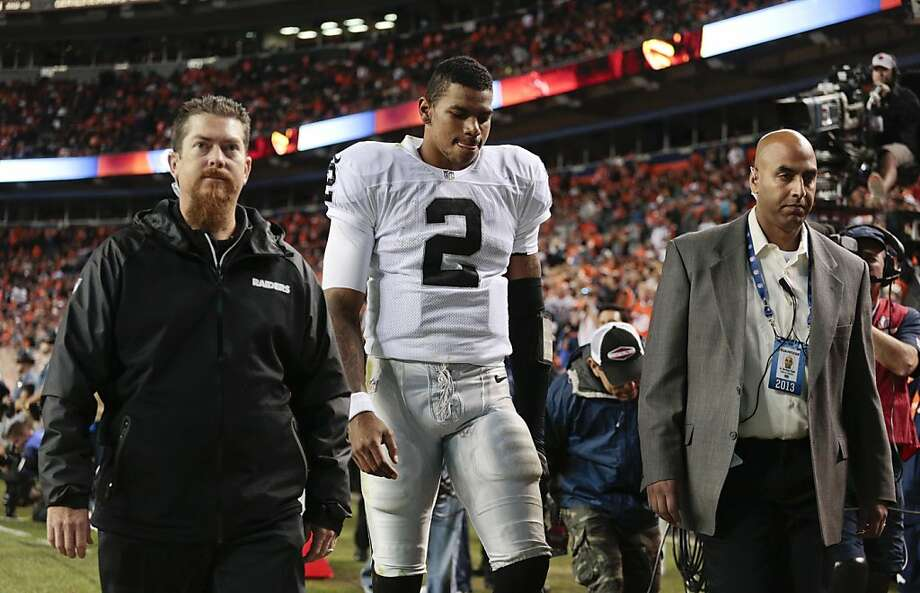 FILE - In this Sept. 23, 2013 file photo, Oakland Raiders quarterback Terrelle Pryor (2) leaves the field late in the fourth quarter of an NFL football game against the Denver Broncos in Denver. The Raiders enter a short week of preparation with uncertainty at quarterback. (AP Photo/Joe Mahoney, File) Photo: Joe Mahoney, Associated Press