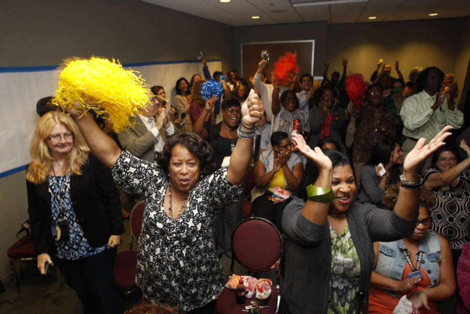 Educators celebrate Wednesday after Houston ISD wins the Broad Prize for Urban Education, becoming the first district to win twice. The $550,000 prize will go to scholarships. Photo: Brett Coomer, Houston Chronicle