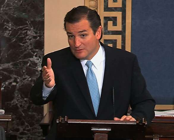 This image from Senate video show Sen. Ted Cruz, R-Texas, speaking on the Senate floor at the U.S. Capitol in Washington, Tuesday, Sept. 24, 2013. Cruz says he will speak until he's no longer able to stand in opposition to President Barack Obama's health care law. Cruz began a lengthy speech urging his colleagues to oppose moving ahead on a bill he supports. The measure would prevent a government shutdown and defund Obamacare. (AP Photo/Senate TV) Photo: Associated Press