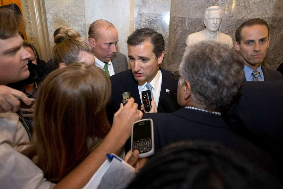 Sen. Ted Cruz, R-Texas speaks to reporters on Capitol Hill in Washington, Wednesday, Sept. 25, 2013, after his marathon speech on the Senate floor. Cruz ended a marathon Senate speech opposing President Barack Obama's health care law after talking for 21 hours, 19 minutes.  (AP Photo/Jacquelyn Martin) Photo: Associated Press