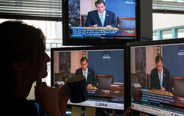 "A journalist watches C-SPAN  TV on computer screens showing US Senator Ted Cruz (R-TX) on September 25, 2013 in Washington,DC. Most US senators expect to pass a stopgap spending bill this week, but one lawmaker is so against it he took to the Senate floor -- for 19 hours and counting. Few knew that Senator Ted Cruz would still be engaged in his talkathon, much less even awake, on Wednesday morning to oppose the temporary budget. But such is his fierce opposition to President Barack Obama's signature health care law, whose funding is part of the bill, that he held the Senate floor through the night, delivering one of the longest Senate speeches since precise record-keeping began in 1900. The conservative first-term lawmaker was voicing what he said is America's deep discontent for the law known as ""Obamacare,"" and aimed to unite Republicans in opposition to passing a spending bill that does not defund the health care law. AFP PHOTO/MLADEN ANTONOVMLADEN ANTONOV/AFP/Getty Images Photo: AFP/Getty Images"
