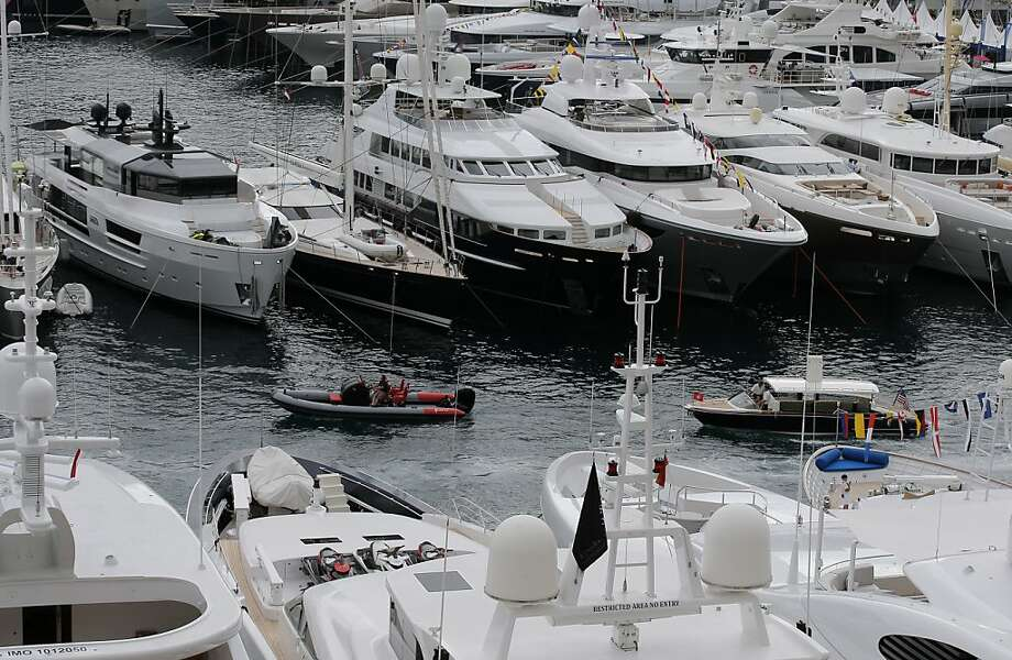 I'll take that one in the middle: Yachts are showing at the 24th edition of the Monaco Yacht Show, Wednesday, Sept. 25, 2013, in Monaco.The Monaco Yacht Show, taking place at Port Hercules in Monaco, is the only boat show devoted exclusively to luxury yachting. Photo: Lionel Cironneau, Associated Press