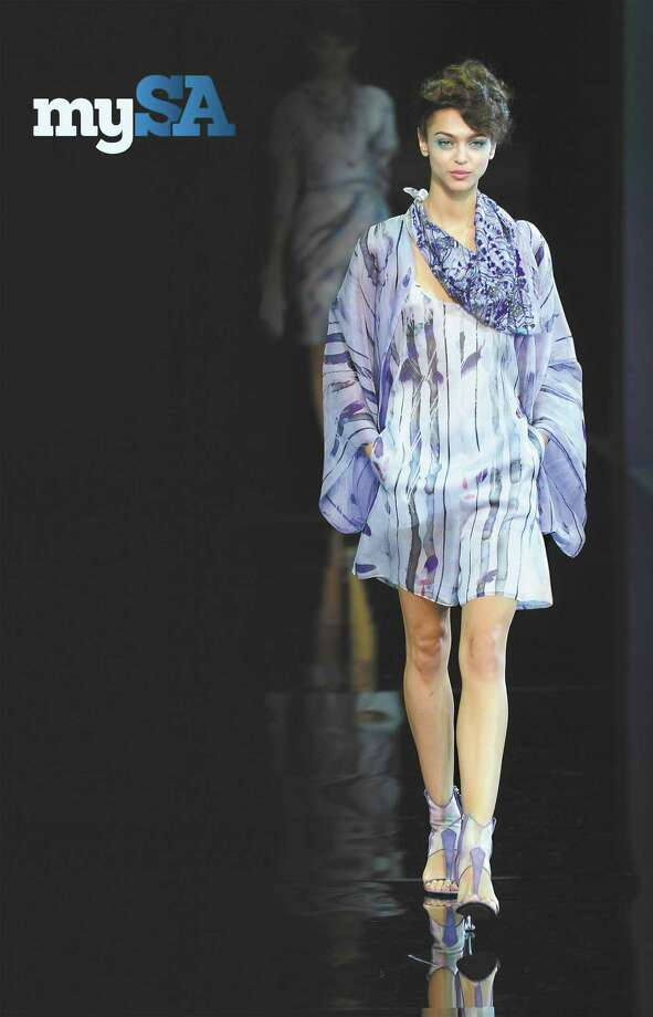 Giorgio Armani choose lightweight fabrics in shadowy layers and a mix of silks and knits to create a pale shimmering effect for spring and summer. Photo: Giuseppe Cacace / Getty Images