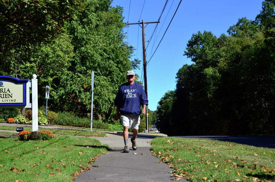 Al Forte, 70, of Stamford, has been walking since Aug. 31 when he left Boston and has been making his way to ground zero in lower Manhattan to spead his message: Pray for Peace. Photo: Megan Spicer