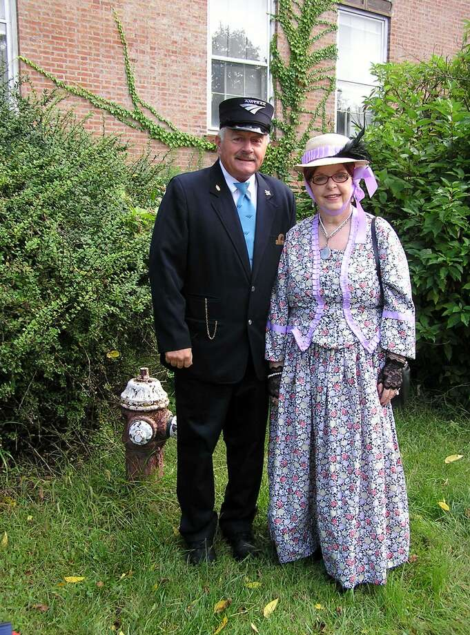 Mike Stammel portrays a railroad conductor and Michele Pollard-Foley a historic character during the Friends of Rensselaer Library?s Trolley Tour, part of the Historic Tour of Rensselaer on Sept. 14 that included homes and sites in the city, along with the Fort Crailo Harvest Faire. People in period costumes came on the trolley and talked about specific places of interest. (Jean Francois)